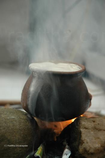 Boiling milk on a fire